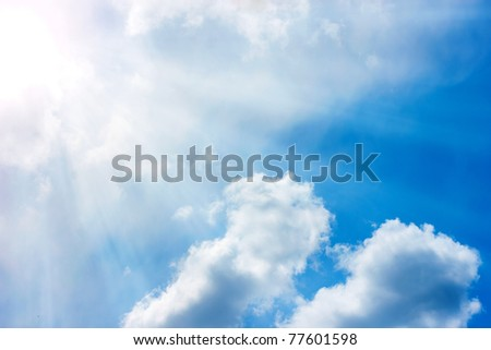 Beautiful sky with clouds and sunbeam for background