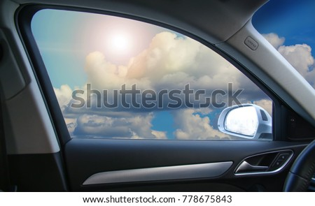 Beautiful Sky with Sun and Clouds from the window of the car