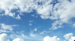 Beautiful sky with white clouds at noon, a bird is visible
