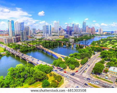 Beautiful Skyline Aerial View of Austin Texas with Water Reflections and Bridges