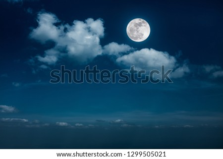 Beautiful skyscape. Landscape of night sky with clouds and bright full moon. Serenity nature background, outdoor at nighttime with moonlight. The moon taken with my own camera. #1299505021