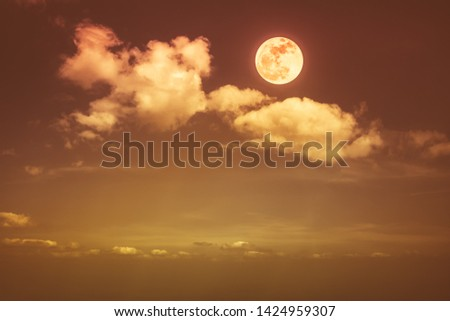 Beautiful skyscape. Landscape of night sky with clouds and bright full moon. Serenity nature background, outdoor at nighttime with moonlight. Sepia tone. The moon taken with my own camera. #1424959307