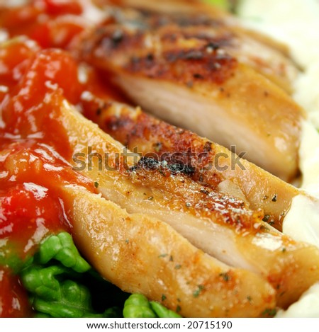 Beautiful sliced roasted chicken with tomato salsa and lettuce.