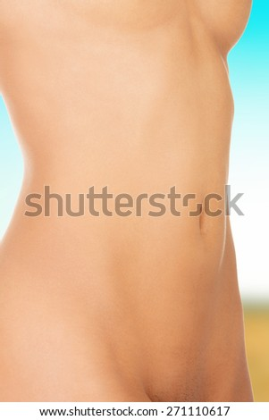 Beautiful slim female naked belly.
