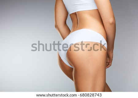 Beautiful Slim Woman Body. Closeup Of Healthy Girl With Fit Body, Soft Skin, Tight Hips And Firm Buttocks In Bikini Underwear. Perfect Female Body In Shape With Sexy Back And Big Butt. High Resolution