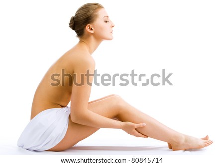 Beautiful slim woman in spa center on white background