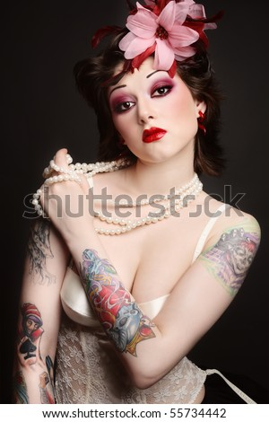 stock photo : Beautiful slim young tattooed woman in ballet skirt and