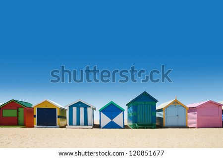Beautiful small bathing houses on white sandy beach at Brighton Beach, Australia