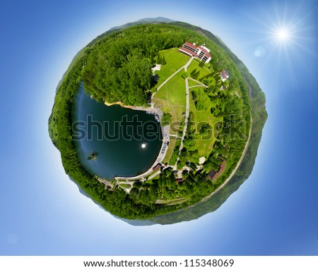 Beautiful small green village from above (aerial view) little planet concept