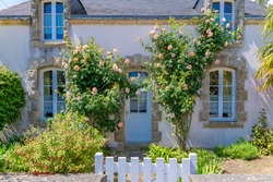 Beautiful small house in Brittany, typical home with rosebush and a wooden gate