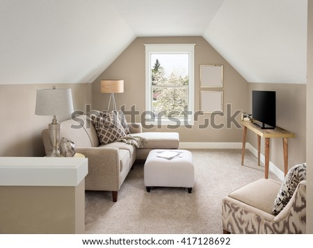 Beautiful small living room interior and loft in new home with sloping roof #417128692