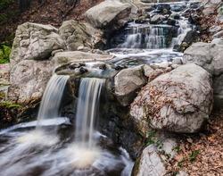 Beautiful small waterfall cascading over rocks