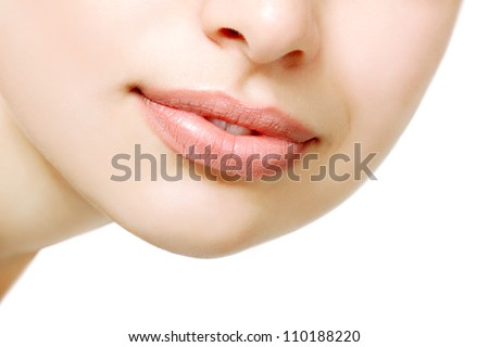 Beautiful smile of young fresh woman. Female lips closeup. Isolated over white background.
