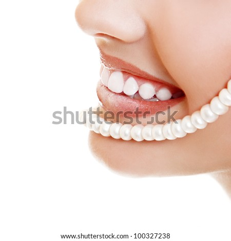 Beautiful smile of young fresh woman with great healthy white teeth and perls. Isolated over white background