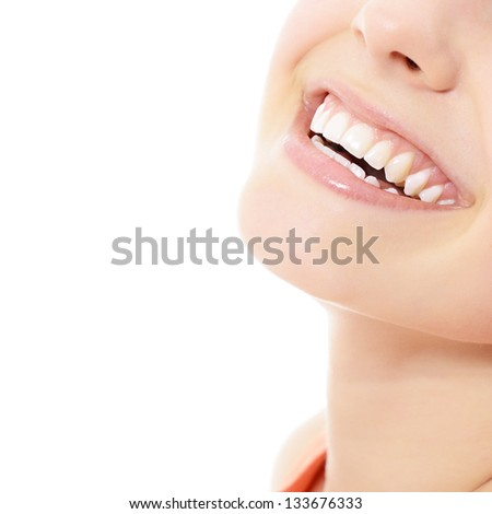 Beautiful smile of young fresh woman with great healthy white teeth over white background