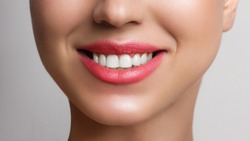 Beautiful smile with whitening teeth. Dental photo. Macro closeup of perfect female mouth, lips care. Stomatology, cosmetology