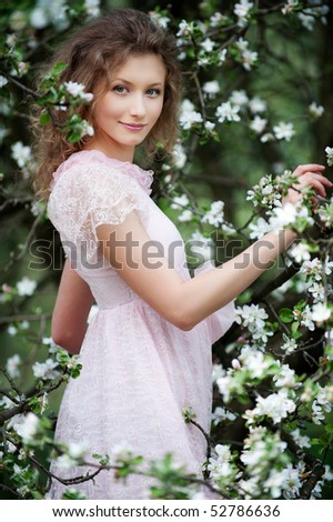 beautiful smiley model posing in white flowers