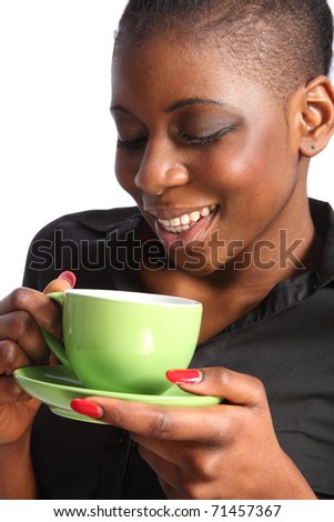 Beautiful smiling black woman drinking cup of tea