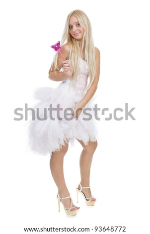 Beautiful smiling blond girl with magic wand isolated on white background