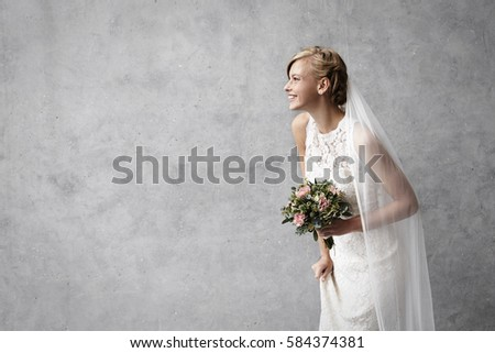 Beautiful smiling bride in studio