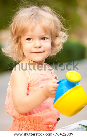 Beautiful smiling child in summer garden