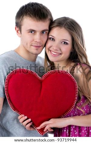 beautiful smiling couple on white background with red heart