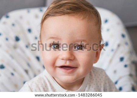 Beautiful smiling cute baby. Beautiful expressive adorable happy cute laughing smiling baby infant face. Children, people, infancy and age concept - beautiful happy baby