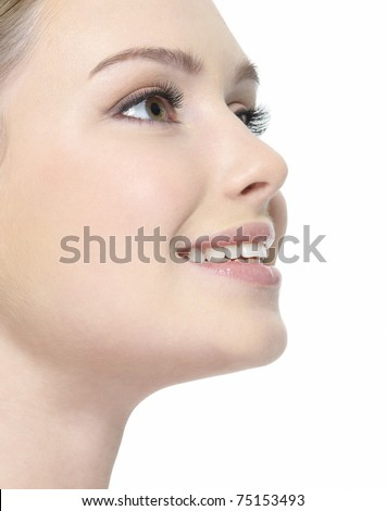 Beautiful smiling face of woman close-up in profile - white background