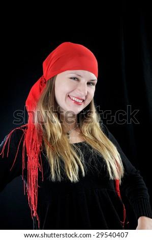 Beautiful smiling fortuneteller, on black background
