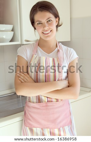 beautiful smiling girl in the kitchen