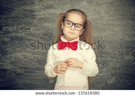 Beautiful smiling girl on a black background. School concept - stock photo