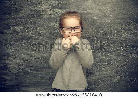 Beautiful smiling girl on a black background. School concept