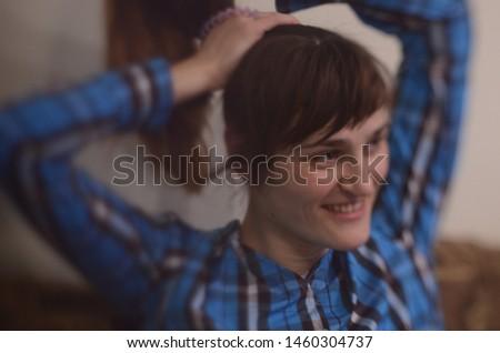 Beautiful smiling girl wearing plaid  shirt. #1460304737