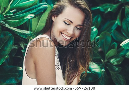Beautiful smiling girl with eyes closed