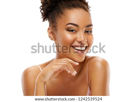 Beautiful smiling girl with flawless skin. Portrait of african american girl on white background. Youth and skin care concept