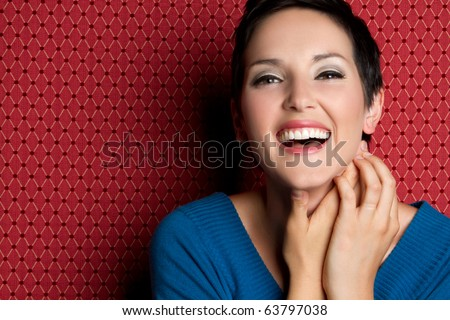 Beautiful smiling laughing young woman