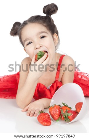 Beautiful smiling little girl in red dress with strawberry over white - stock photo