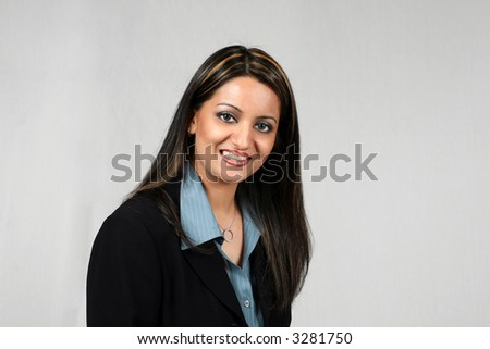 Beautiful smiling Middle Eastern Business Woman isolated on white in suit