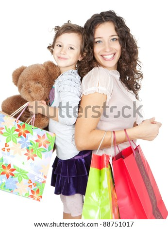 beautiful smiling mother and little daughter doing shopping together over white background