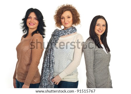 Beautiful smiling three women friends standing in a line isolated on white background