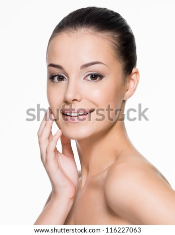 Beautiful smiling woman cares for the skin face- posing at studio  isolated on white