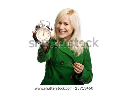 Beautiful smiling woman holding alarm clock isolated on white