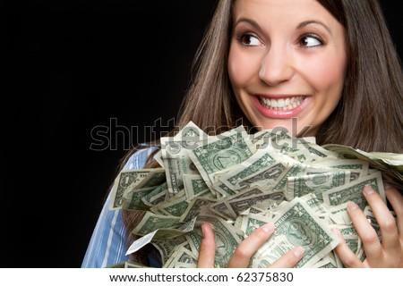 Beautiful smiling woman holding money - stock photo