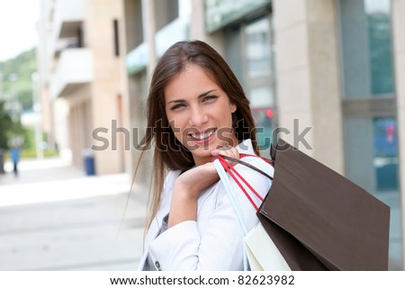Beautiful smiling woman holding shopping bags