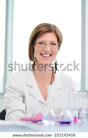 Beautiful smiling woman in laboratory