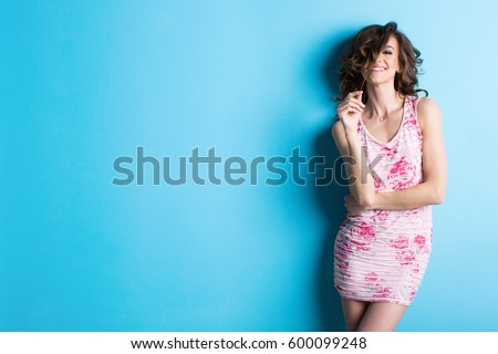 Beautiful smiling woman on blue background. #600099248