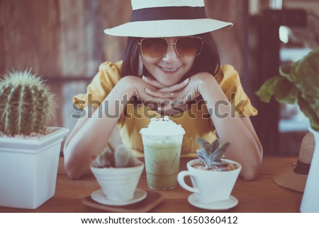 Beautiful smiling woman sitting in coffee shop,Happy and smile,Relaxing time