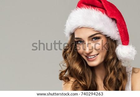 Stock Photo Beautiful smiling woman wear santa claus hat