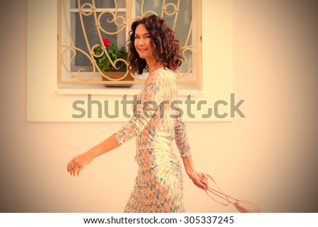 beautiful smiling woman with a...