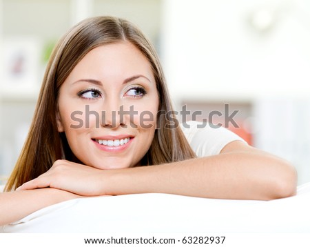 Beautiful smiling womans face looking away - indoors